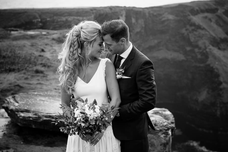 B&W Cliff Top Intimate Moment Aoibin and John