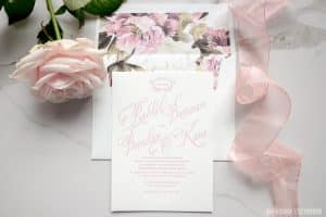 Wedding invitation printed in pink with matching envelope liners